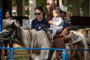 child riding a pony at Tallahassee's Springtime festival