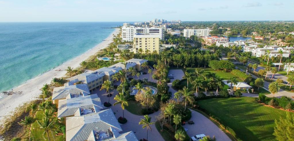 Naples, Florida beachfront and cityscape