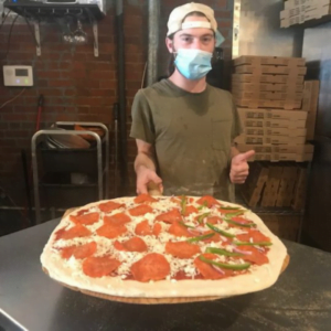 Pizza ready for the oven at Decent Pizza in Tallahassee, FL